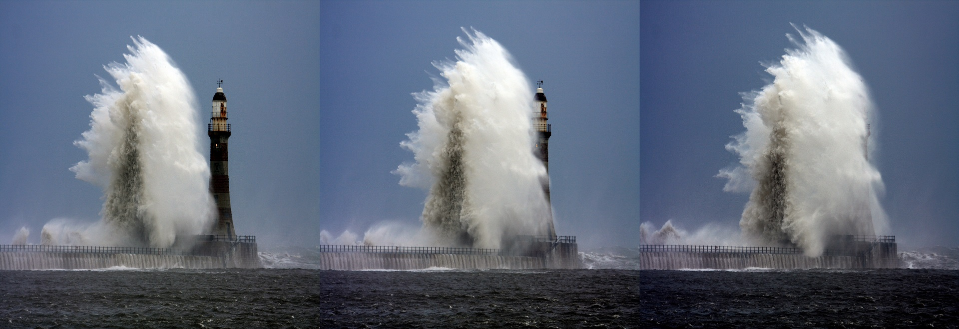 A lighthouse in a rough sea, a wave breaks against it.